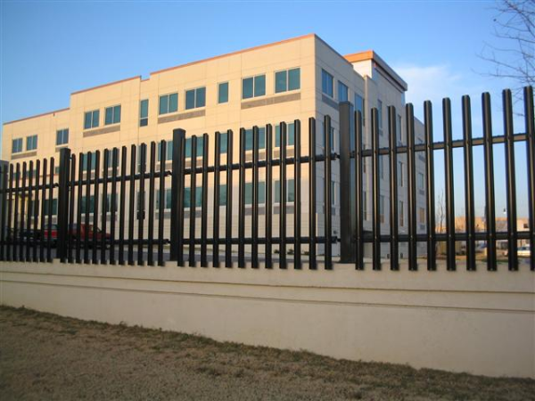 A building under renovation uses ameristar black galvanized steel with sharp picket points to deter access to the area