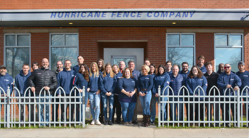 Hurricane Fence Company team standing in front of office